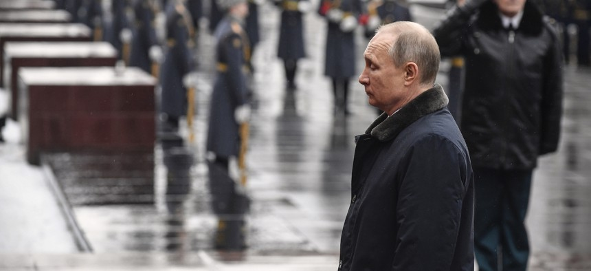 Russian President Vladimir Putin attends a wreath-laying ceremony at the Tomb of the Unknown Soldier, near the Kremlin during the national celebrations of the 'Defender of the Fatherland Day' in Moscow, Russia, Sunday, Feb. 23, 2020.