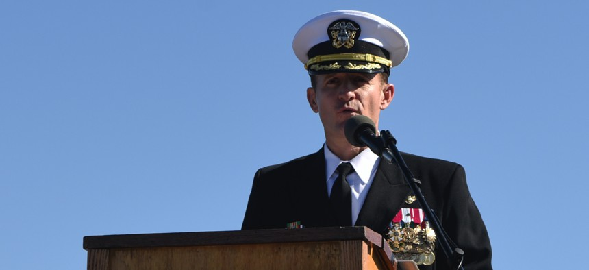 In this November 2019 photo, Capt. Brett Crozier addresses the crew for the first time as commanding officer of the aircraft carrier USS Theodore Roosevelt (CVN 71) during a change of command ceremony on the ship's flight deck.