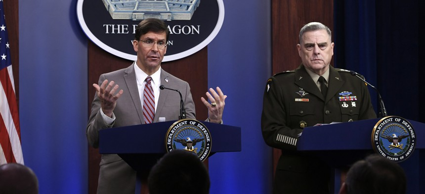 In this Monday, March 2, 2020 file photo, U.S. Defense Secretary Mark Esper, left, speaks during a briefing with the Chairman of the Joint Chiefs of Staff Army Gen. Mark Milley, at the Pentagon in Washington.