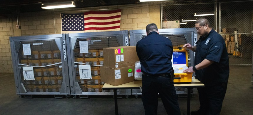 Coordinators at the New York City Emergency Management Warehouse, pack up a ventilator, part of a shipment of 400, that arrived Tuesday, March 24, 2020 in New York.