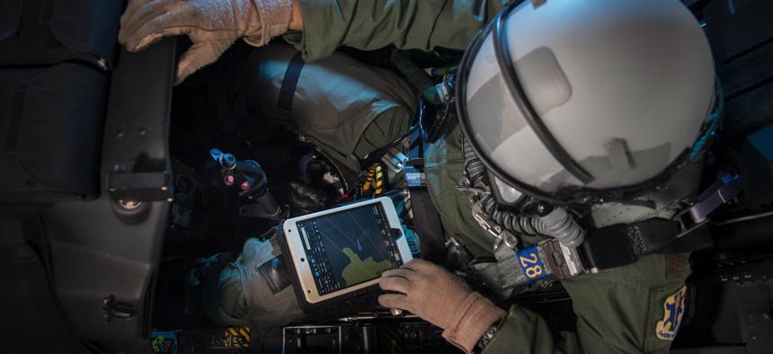 Maj. Earl Arnold, 12th Flying Training Wing electronic flight bag program manager, does preflight checks on a T-6 Texan using an electronic flight bag Feb. 13, 2018, at Joint Base San Antonio-Randolph.