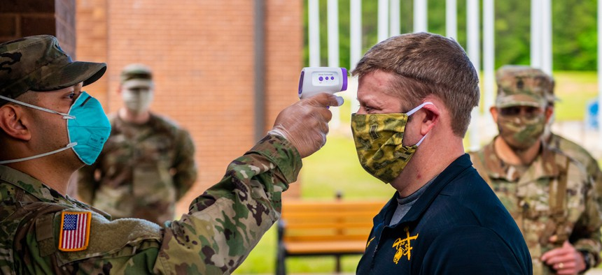 FORT BENNING, Ga. - Secretary of the Army Ryan McCarthy has his temperature taken at 30th Adjutant Battalion (Reception) during his visit to the Maneuver Center of Excellence April 29.