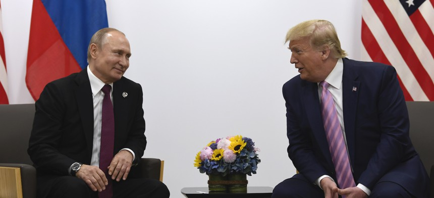 In this June 28, 2019, file photo, President Donald Trump, right, meets with Russian President Vladimir Putin during a bilateral meeting on the sidelines of the G-20 summit in Osaka, Japan.