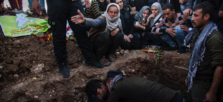 In this March 10, 2010, file, photo, people attend the funeral of a Syrian Democratic Forces fighter who was killed in a battle with remnants of the Islamic State group in eastern Syria