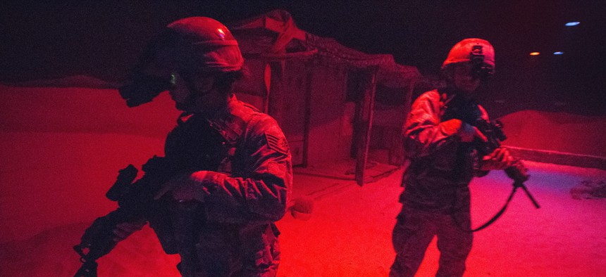 U.S. Air Force Airmen with the 514th Security Forces Squadron, 514th Air Mobility Wing, maneuver through the indoor urban operations site during a training exercise at the New Jersey National Guard's Joint Training and Training Development Center.