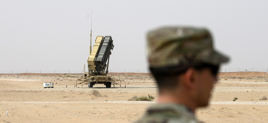 A member of the U.S. Air Force stands near a Patriot missile battery at the Prince Sultan air base in al-Kharj, central Saudi Arabia, Thursday, February 20, 2020.