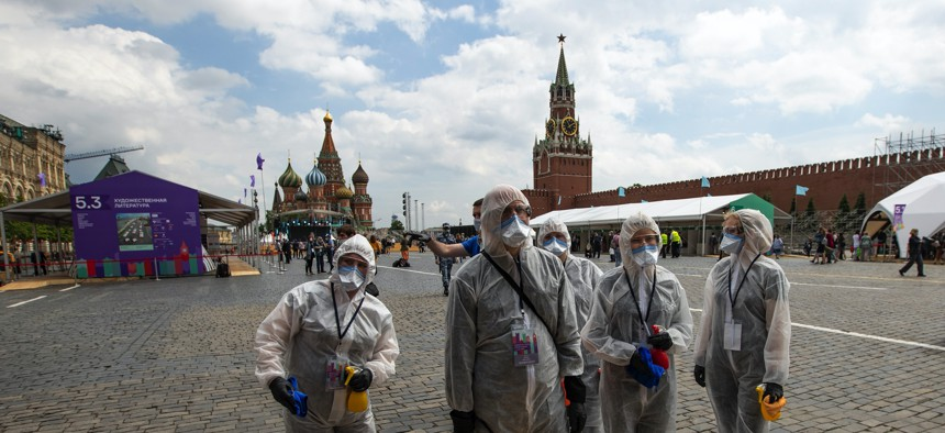 Volunteers wearing face masks, gloves and protective gear to protect against coronavirus in Moscow, Russia, Saturday, June 6, 2020.