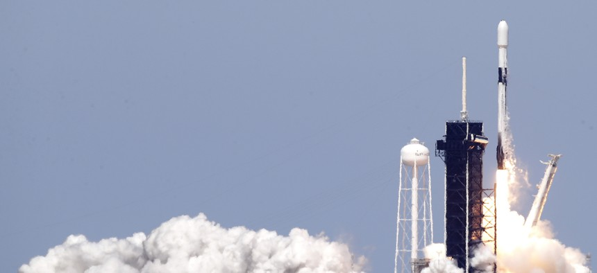 A Falcon 9 SpaceX rocket with the seventh batch of approximately 60 satellites for SpaceX's Starlink broadband network, lifts off from pad 39A at the Kennedy Space Center in Cape Canaveral, Fla., Wednesday, April 22, 2020.