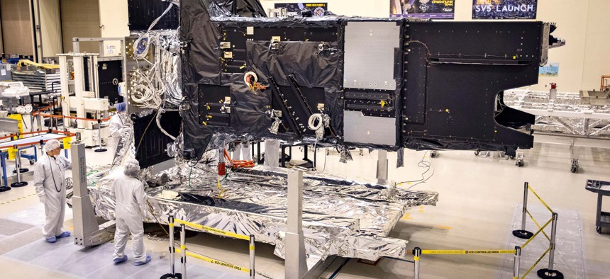 Lockheed Martin's fully-assembled SBIRS GEO 5 missile warning satellite moves into the Thermal Vacuum (TVAC) test chamber on April 1, 2020.