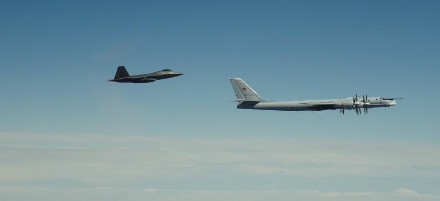 An F-22 Raptor assigned to Joint Base Elmendorf-Richardson, in Alaska, intercepts a Russian Tu-95 Bear on June 9, 2020.