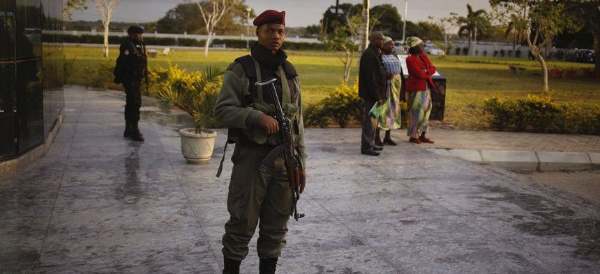 A Mozambican soldier provide security before the arrival of India's Prime Minister Narendra Modi at a technical school in Maluana, Mozambique, Thursday, July 7, 2016