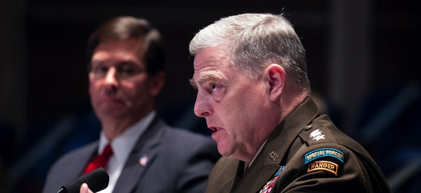 Defense Secretary Mark Esper, left, listens as Chairman of the Joint Chiefs of Staff Gen. Mark Milley testifies during a House Armed Services Committee hearing on Thursday, July 9, 2020, on Capitol Hill in Washington.