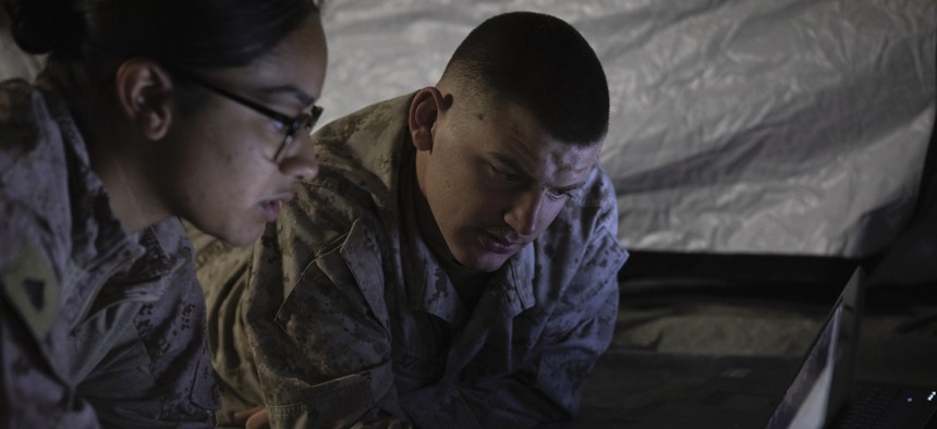 UU.S. Marines with the Special Purpose Marine Air Ground Task Force 19.2 Crisis Response Command Element prepare field condition crisis response center networks in Kuwait, Aug. 23, 2019.