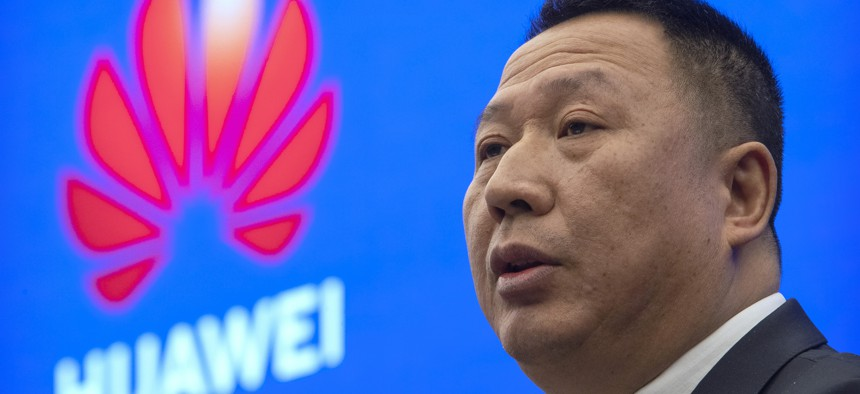 Song Liuping, chief legal officer of Huawei, speaks during a press conference at Huawei's campus in Shenzhen in southern China's Guandong Province, Thursday, Dec. 5, 2019.