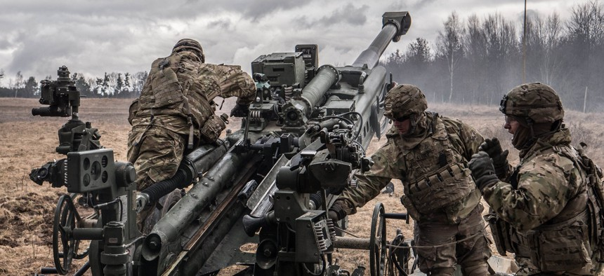 U.S. soldiers prepare to fire Howitzer during exercise Dynamic Front at Grafenwoehr military base, Germany on March 7, 2018.