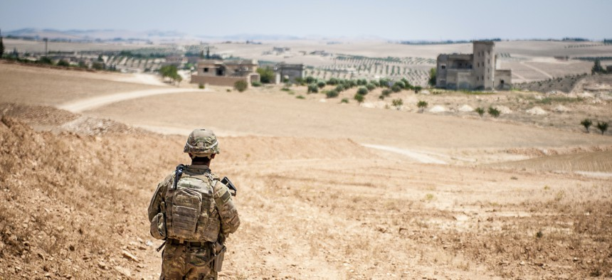 A U.S. soldier provides security near a village outside Manbij, Syria, in 2018.