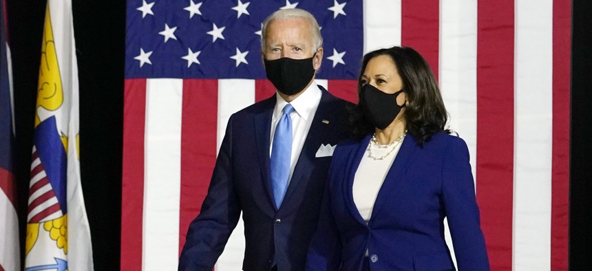 Democratic presidential candidate former Vice President Joe Biden and his running mate Sen. Kamala Harris, D-Calif., arrive to speak at a news conference at Alexis Dupont High School in Wilmington, Del., Wednesday, Aug. 12, 2020.