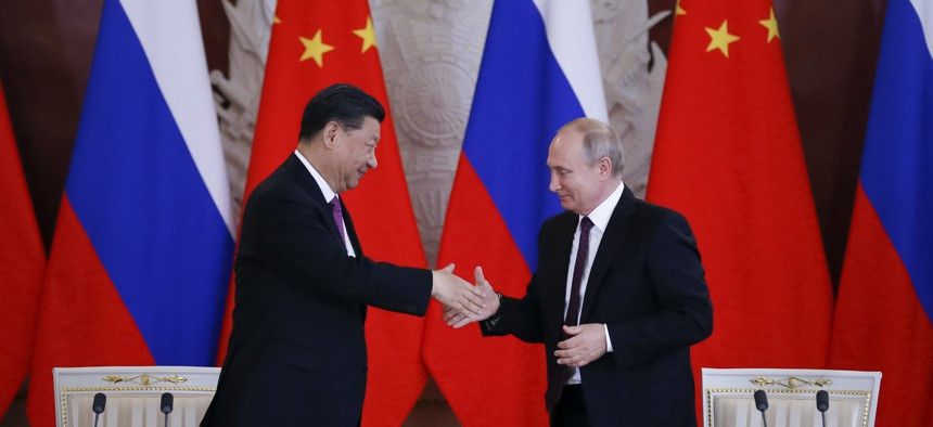 Russian President Vladimir Putin and Chinese President Xi Jinping attend a welcome ceremony prior to their talks in the Kremlin in Moscow, Russia, Wednesday, June 5, 2019.