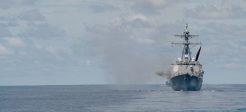 The Arleigh Burke-class guided-missile destroyer USS Sterett (DDG 104) fires its Mark 45 5-inch gun during a live-fire exercise in the Indian Ocean with the Nimitz Carrier Strike Group, July 20, 2020.