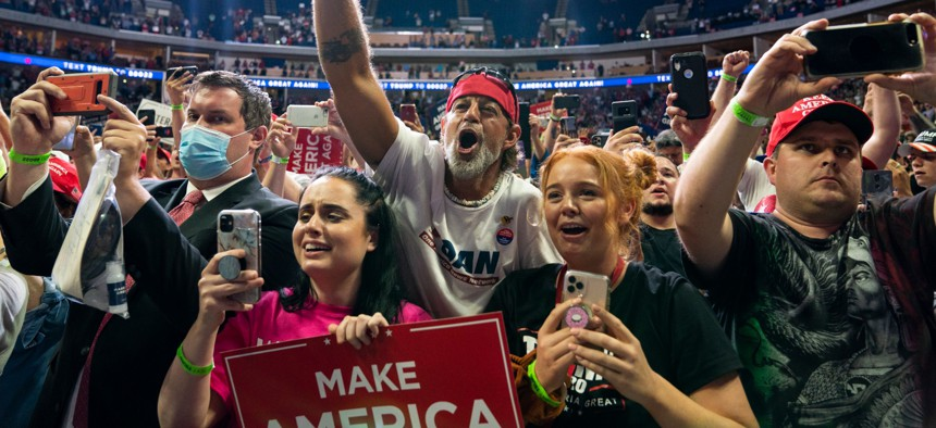 Supporters of President Donald Trump cheer as he arrives on stage to speak to a campaign rally at the BOK Center, Saturday, June 20, 2020, in Tulsa, Okla.