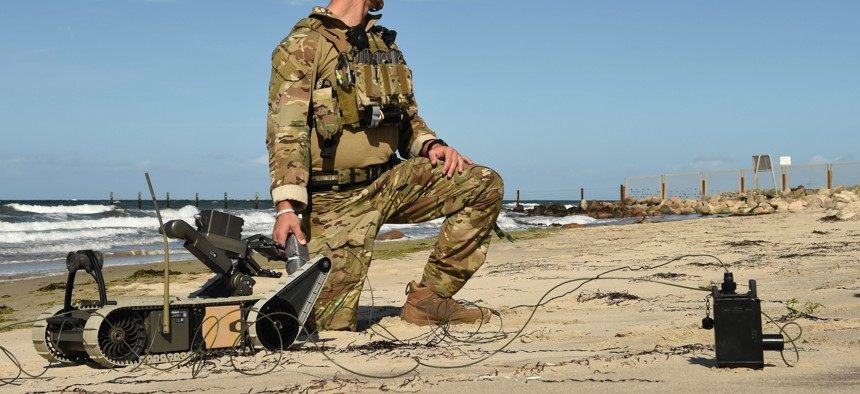 An explosive ordnance disposal technician prepares a remote-controlled robotic for a mission during Exercise Northern Coasts in Putlos, Germany, Sept. 13, 2019.