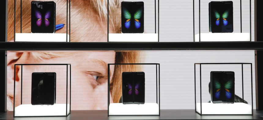 Galaxy Fold 5G phones are on display at the Samsung booth during the CES tech show, Tuesday, Jan. 7, 2020, in Las Vegas.