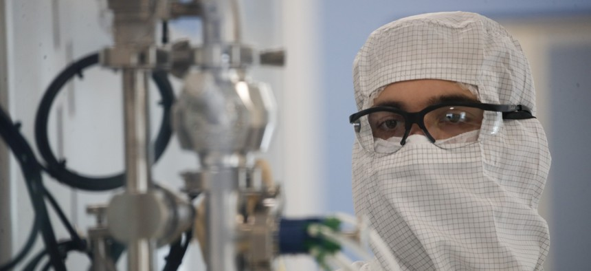 A laboratory technician works at the mAbxience biopharmaceutical company in Garin, Argentina, Friday, Aug. 14, 2020. Under an agreement between Argentina and Mexico announced this week, the company is going to make an AstraZenneca-Oxford COVID19 vaccine