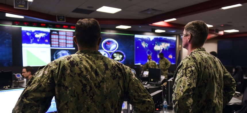 Sailors stand watch at headquarters of U.S. Fleet Cyber Command/U.S. 10th Fleet at Fort Meade, Maryland, in 2018