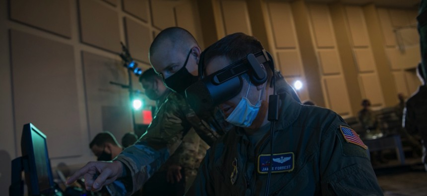 Lt. Col. James Forrest operates a virtual-reality headset in support of the Advanced Battle Management System, or ABMS, Onramp, Sept. 2, 2020, at Joint Base Andrews, Md.
