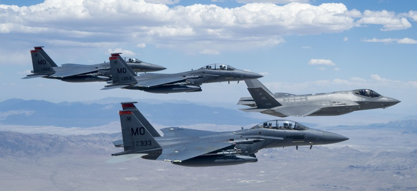 Then-Lt. Gen. Mark Kelly leads a formation of F-35 Lightning ll and F-15E Strike Eagles over the Utah Test and Training Range in July 2018.