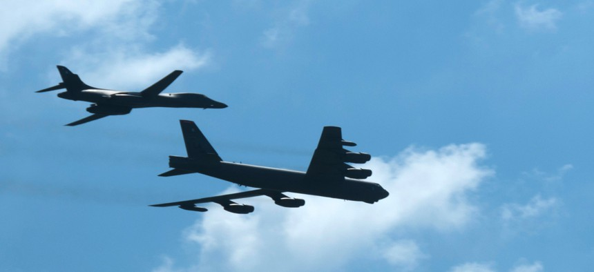 A B-1 Lancer and a B-52 Stratofortress fly over Barksdale Air Force Base, La., in 2015.