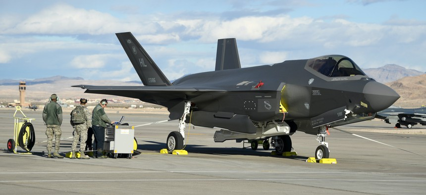 Crew chiefs with the USAF's 4th Aircraft Maintenance Unit recover F-35A Lightning II fighter jets at Nellis Air Force Base, Nevada, Feb. 6, 2019.