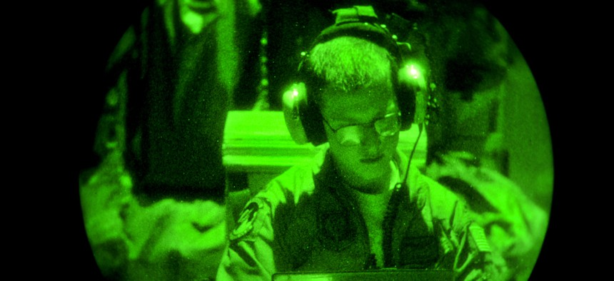 An aircrew member from the 522nd Special Operations Squadron reviews his in-flight checklist aboard an MC-130J Commando II from Cannon Air Force Base, N.M., Aug. 22, 2012.
