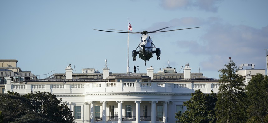 The helicopter that carried President Donald Trump to Walter Reed National Military Medical Center in Bethesda, Md., lands on the South Lawn of White House in Washington, Friday, Oct. 2, 2020.