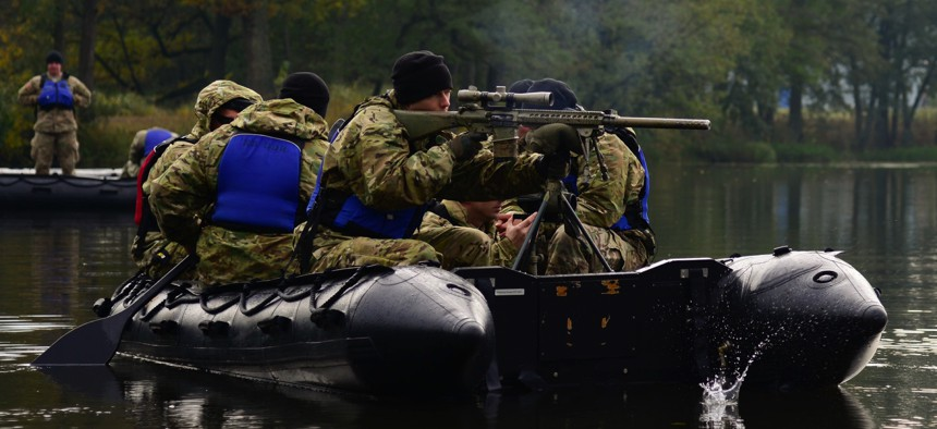 A U.S. soldier fires at a target from a Zodiac boat at the 7th Army Training Command's Grafenwoehr Training Area in Germany in 2016.