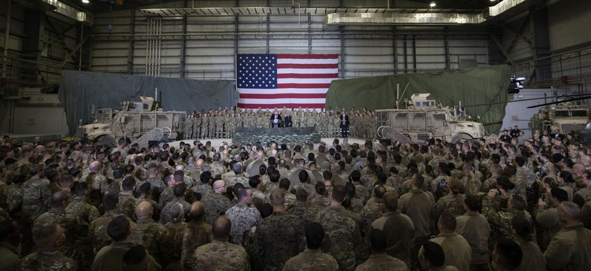 President Donald Trump addresses members of the military during a surprise Thanksgiving Day visit, Thursday, Nov. 28, 2019, at Bagram Air Field, Afghanistan.