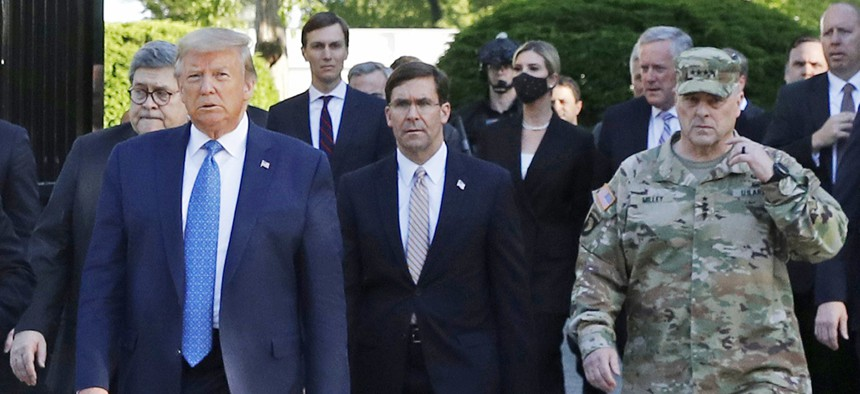 In this June 1, 2020, file photo, President Donald Trump departs the White House to visit outside St. John's Church, in Washington. Walking behind Trump from left are, Attorney General William Barr, Secretary of Defense Mark Esper and Gen. Mark Milley.