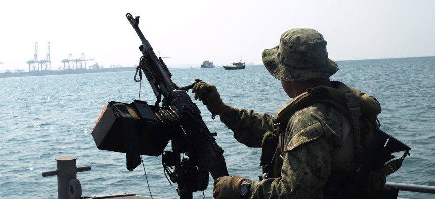 A U.S. sailor assigned to Coastal Riverine Squadron 10 provided seaward security for a vessel at the Port of Djibouti in 2015.