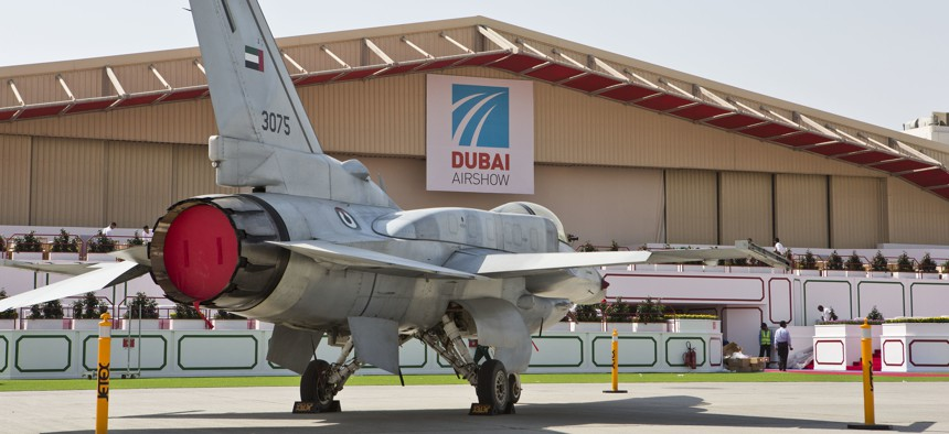 The UAE Block 60 F-16 stands strong out in front of the Dubai Airshow hanger.