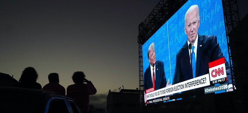 President Donald Trump and former Vice President Joe Biden speak as people watch at Fort Mason Center in San Francisco on Oct. 22, 2020.