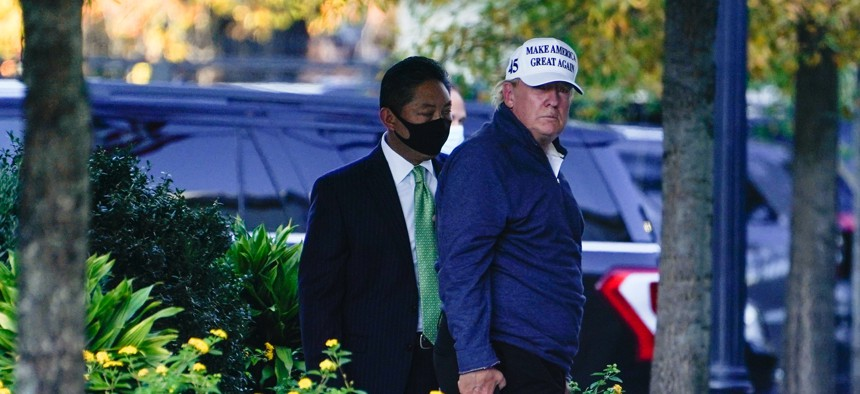 President Donald Trump returns to the White House after playing a round of golf, Saturday, Nov. 7, 2020, in Washington.