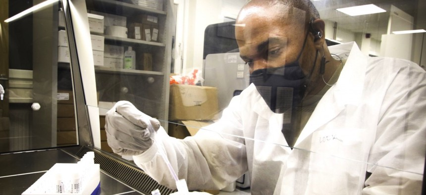 U.S. Army Spc. Donald Lockhart, laboratory technician, Department of Pathology and Laboratory Services, Landstuhl Regional Medical Center, prepares a COVID-19 sample for testing at LRMC, Nov. 3.