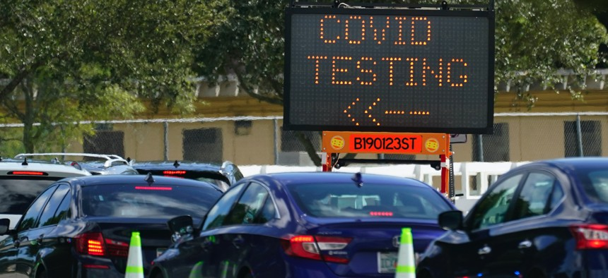 Cars line up at a COVID-19 testing site at Tropical Park, Saturday, Nov. 14, 2020, in Miami.