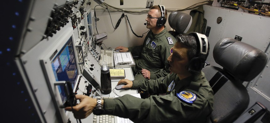 Inside a NATO AWACS plane during a patrol over Romania and Poland in 2014.