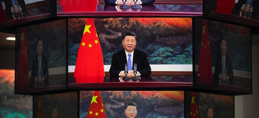 Video screens show Chinese President Xi Jinping as he delivers an address to the opening ceremony of the China International Import Expo in Shanghai, Wednesday, Nov. 4, 2020.