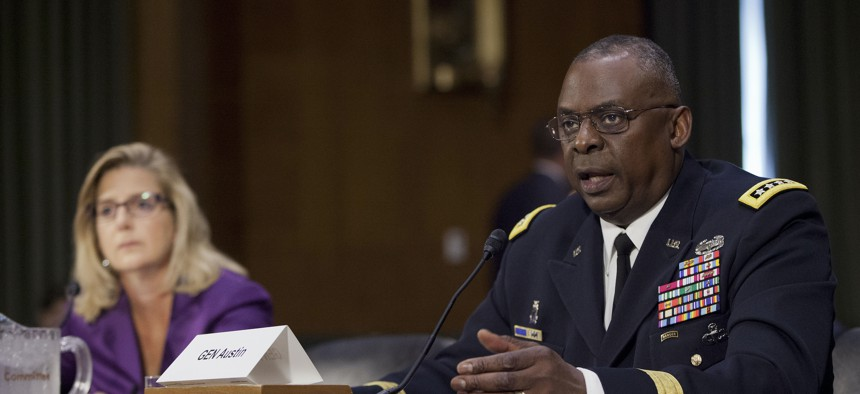 Then-CENTCOM commander Gen. Lloyd Austin III, right, testifies in 2015 before the Senate Armed Services Committee.