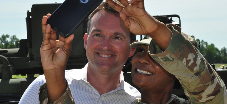 A National Guardsman takes a selfie with then-Army Secretary Eric Fanning in 2016.
