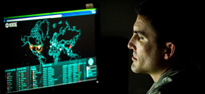 An Airman monitors live cyber attacks on the operations floor of the 27th Cyberspace Squadron, known as the Hunter's Den, at Warfield Air National Guard Base, Middle River, Md., June 3, 2017.