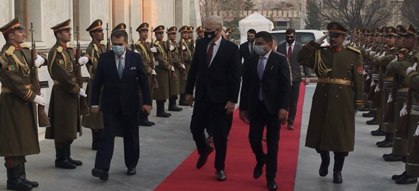 Acting Defense Secretary Christopher Miller enters the Afghanistan Presidential Palace on Tuesday, Dec 22, 2020