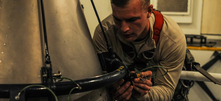 Senior Airman Andrew Parrish, 90th Missile Maintenance Squadron topside technician, performs maintenance on the forward section of a reentry system, Feb. 2, 2018, in the F. E. Warren Air Force Base missile complex.